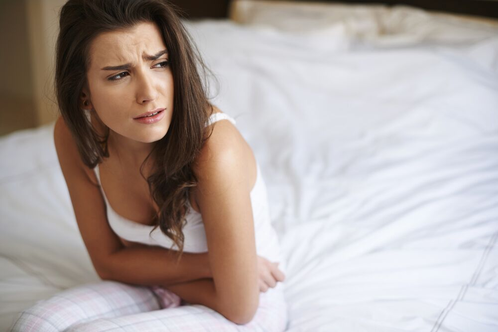 Woman with cramps and PMS