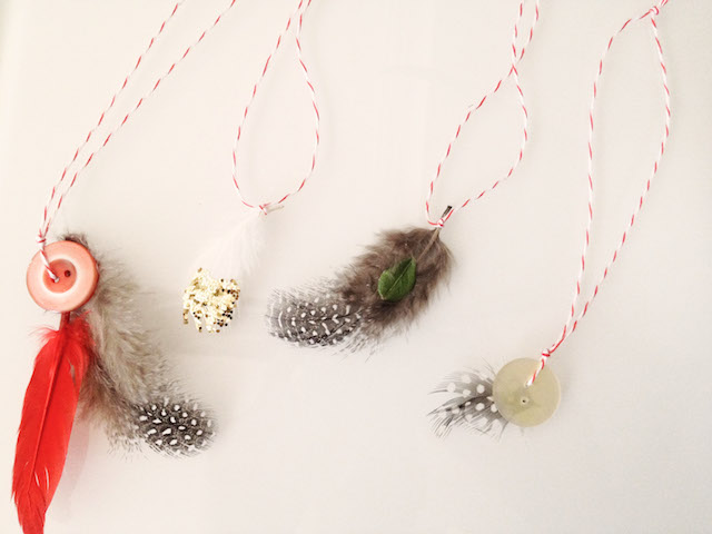 feather ornaments on string