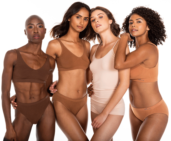 four ethnically diverse women wearing various natural shaded of underwear