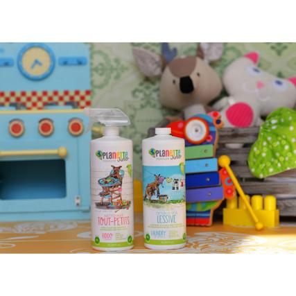 bottles of Planette baby cleaning products with toys behind them