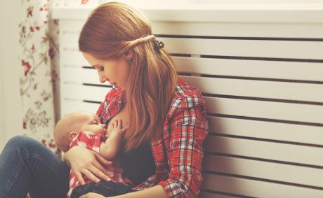 woman in plaid shirt breastfeeding