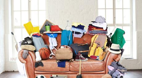 couch piled high with stuff