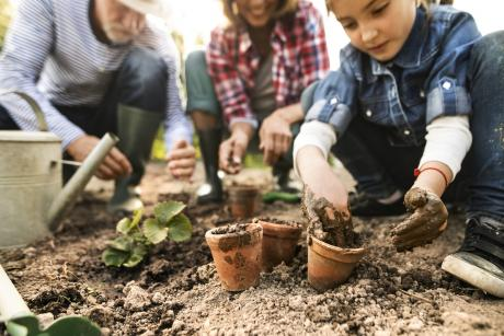 kids gardening in the mud