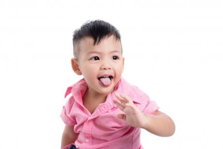 little boy with thrush on his tongue