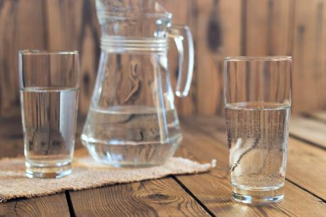 a pitcher and two glasses of water