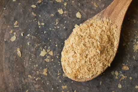 wooden spoon full of nutritional yeast