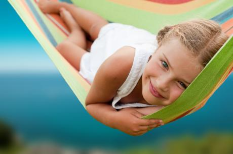 young girl lying in hammock