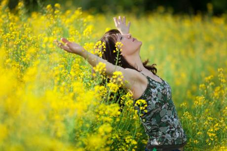 woman surrounded by a field of ragweed