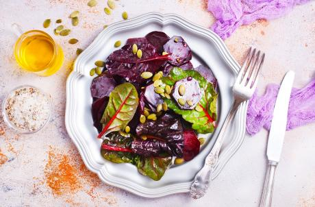 beet salad with nuts on metal plate
