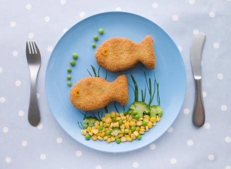 child's dinner plate with fish and veggies