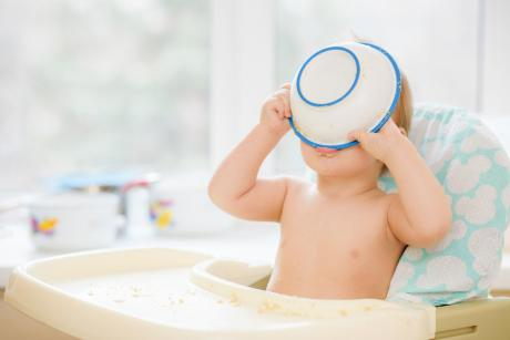 baby drinking from cereal bowl