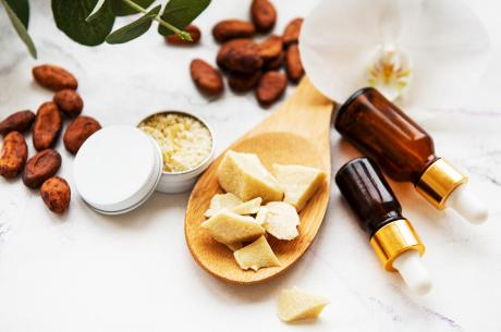 assortment of natural beauty ingredients almonds, oils, beeswax