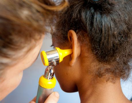 Doctor looking in a child's ear
