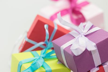 colourful gifts boxes wrapped with ribbons